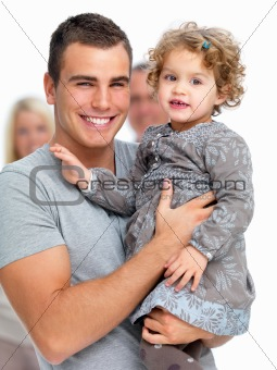 Proud young father holding his daughter in his arms