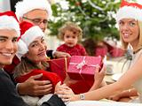 Joyful family opening christmas gifts