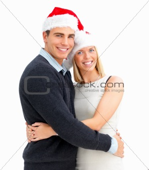 Portrait of young couple being festive at christmas