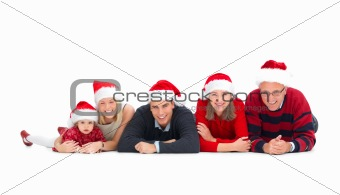 Christmas concept - Family lying in a row