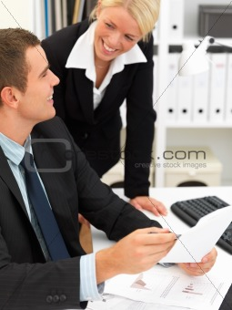 Office life - business man and woman talking about work