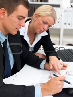 Young business man and woman working in office