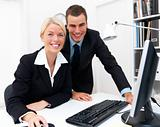 Businessman and woman working in office