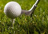 Golf club with ball on a tee & drive