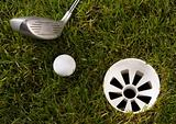 Golf ball on grass with driver