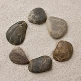 Pebbles in sand ring formation