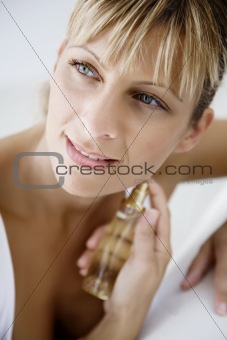 applying perfume