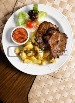 grilled steak with potato chips