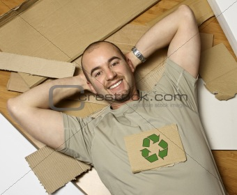 caucasian man and recycling paper