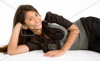 Beautiful Smiling Brunette Lying Down and Relaxing