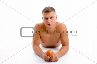 laying fit man with apple