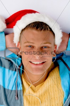 blonde man with christmas hat and ear phones