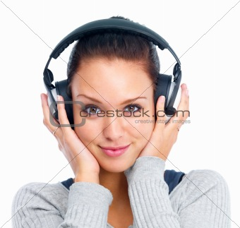 Closeup of a young woman listening to music isolated on white ba