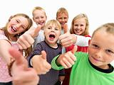 Children giving thumbs up sign