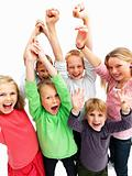 Successful young children raising their hands