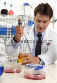 Scientist taking sample with pipette