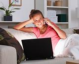 Woman calling from home with laptop