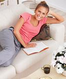 Study - Happy student reading on couch