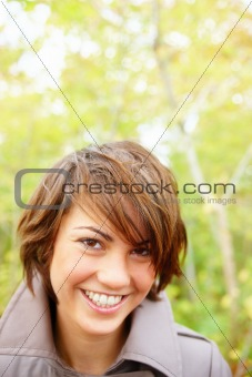  Happy young student out in a forest