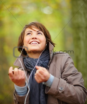 Woman enjoying the fresh autumn weather