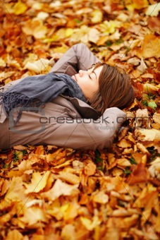 Beautiful woman lying on forest floor