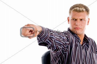 blonde male pointing in front of camera