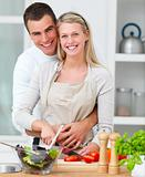 Happy couple  preparing food in the kitchen