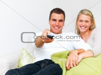 Modern lifestyle -  Couple sitting on  sofa using remote