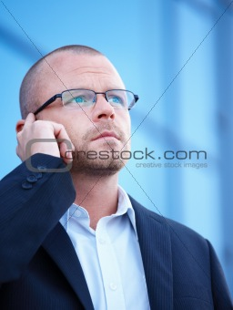 Busy business man talking on cellphone