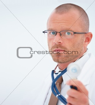 Handsome Doctor standing beside copy space 