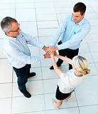Teamwork - business team linking hands