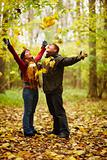 Autumn - Happy couple enjoying falling leaves
