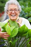 Friendly older woman in her garden