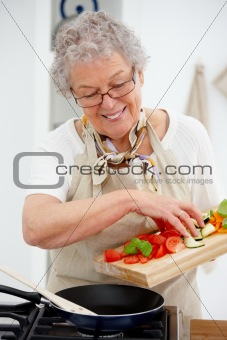 Grandma preparing a meal in the kitchen