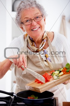 Older woman cooking in a kitchen