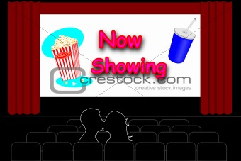 Man and a woman kissing in an empty movie theater