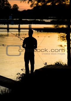 Fishing sunset silhouette