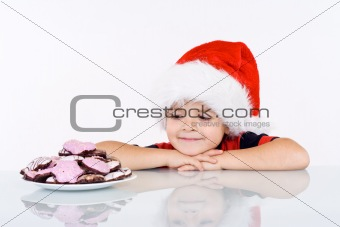 Boy admiring the christmas gingerbread cookies