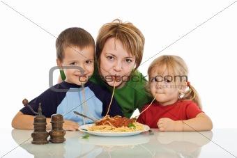Smiley family eating pasta