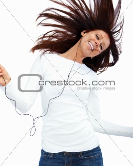 Happy young woman listening to music and  dancing