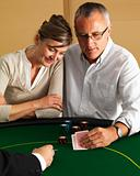 Senior couple playing Blackjack at casino