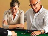 Mature couple gambling at casino