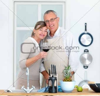 Modern lifestyle - Mature couple standing in kitchen