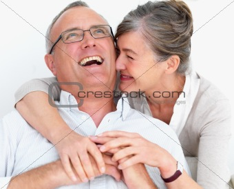 Funny older couple laughing together