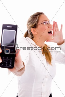 portrait of shouting manager showing cell phone