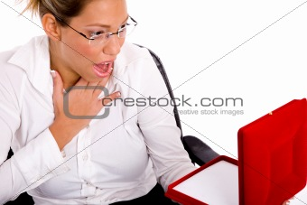 portrait of surprised woman with necklace box