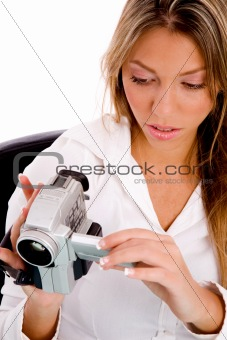 top view of businesswoman holding handy cam