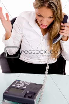 top view of surprised businesswoman holding receiver