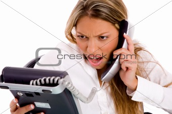 portrait of surprised businesswoman holding phone