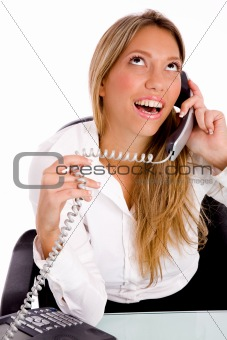 top view of smiling executive busy on phone